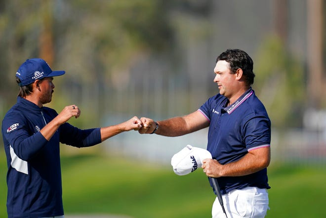 Patrick Reed, right, greets Rickie Fowler after the two finished on the ninth hole of the North Course during the first round of the Farmers Insurance Open golf tournament Thursday at Torrey Pines in San Diego.