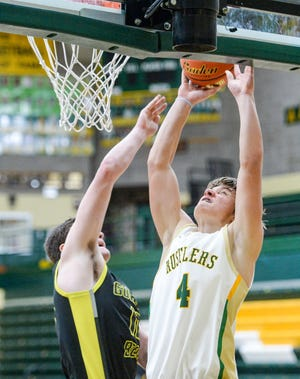 CMR's Cole Taylor goes up for a shot as West's Neil Daily defends during Thursday's basketball game.