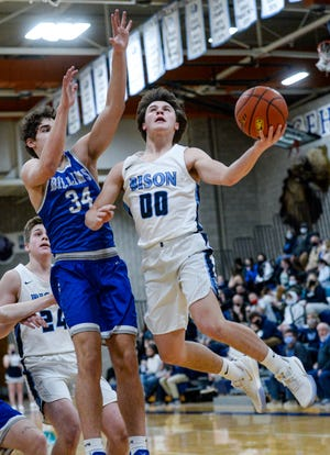 Great Falls High's Levi Torgerson attempts a layup as Billings Skyview's Ky Kouba defends during Thursday's basketball game in the Swarthout Fieldhouse.