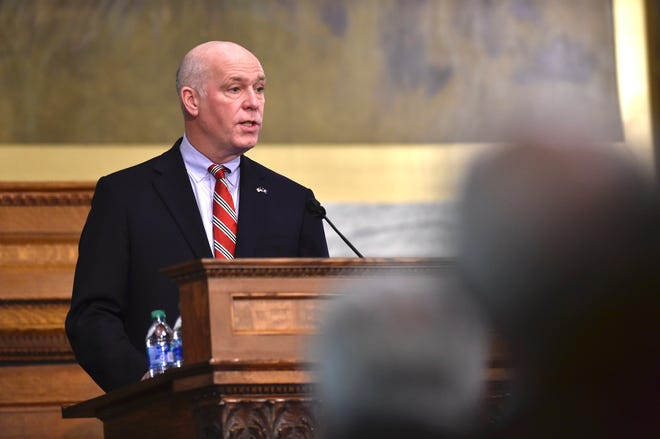 Montana Gov. Greg Gianforte addresses the Legislature on Thursday, Jan. 28, 2021, in the House Chamber of the State Capitol in Helena, Mont. The state's first Republican governor in 16 years delivered his first State of the State address Thursday evening. (Thom Bridge/Independent Record via AP)