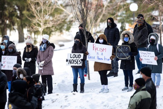 "People hold signs during a protest organized by Action UIowa Task Force to, ""Put DEI in DDS,"" Friday, Jan. 29, 2021, on the University of Iowa campus in Iowa City, Iowa."