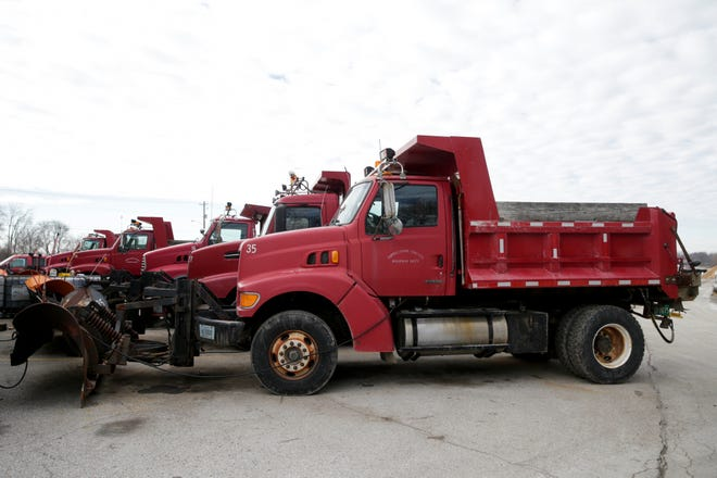 A row of snow plows sit parked at the Tippecanoe County Highway Dept. Garage, Friday, Jan. 29, 2021 in Lafayette.