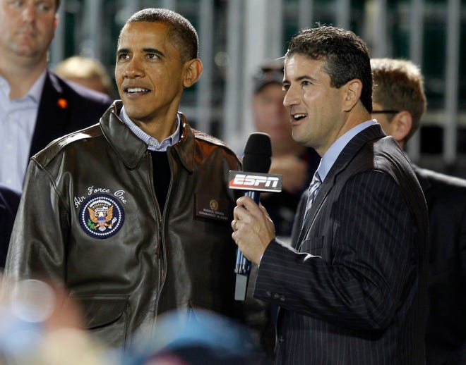 President Barack Obama stands with Andy Katz of ESPN before his interview at the Carrier Classic NCAA basketball game between Michigan State and North Carolina on the USS Carl Vinson, Friday, Nov. 11, 2011, in Coronado, Calif. (AP Photo/Charles Dharapak)