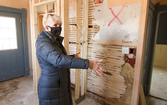 Eileen Zilch, executive director and president of Community Catalysts, shows what will be the kitchen in the downstairs unit of two rentable units in downtown Howell Friday, Jan. 29, 2021.