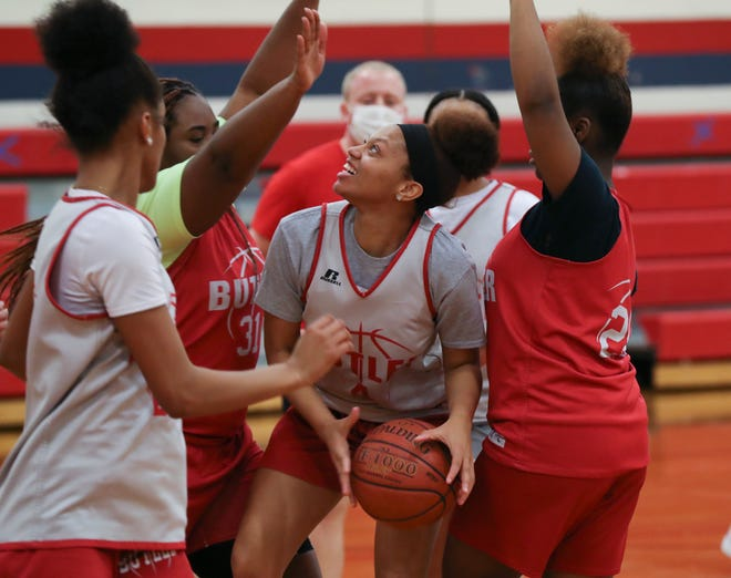 Butler High School's Dynastee White was defended by teammates during practice at the school gym on Jan. 27, 2021.