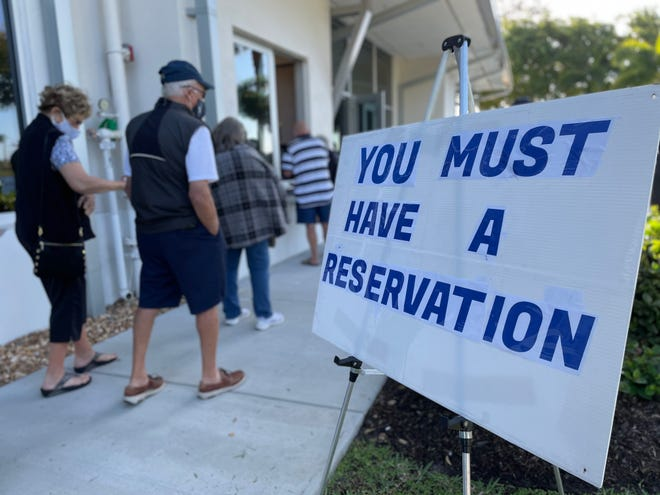 Hundreds of Floridians went to Marco Island's Mackle Park on Friday to get the first dose of the COVID-19 vaccine after makingappointments online earlier in the week.In the photo, people register to get the vaccine at Mackle Park on Jan. 29, 2021.