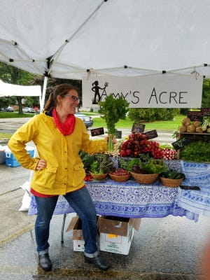 Amy Wallner sets up at the Fox Point Farmers Market.