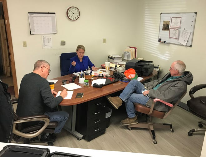 Baxter County Election Commission members, from left, Gary Smith, Judy Garner and Jim Bodenhamer on Friday discuss the special election planned for March 9.