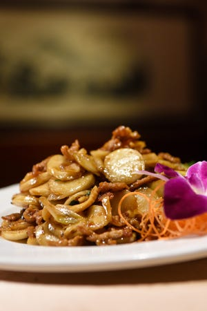 Stir fried New Year rice cakes for Chinese New Year at Hunan Taste in Denville  on Friday January 29, 2021.