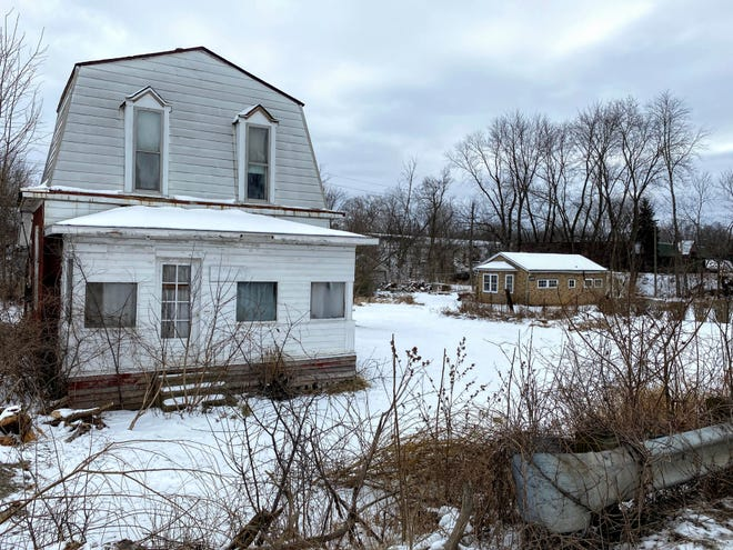 A new medical office is planned to occupy this land containing two homes along Northville Road south of Seven Mile in Northville Township.