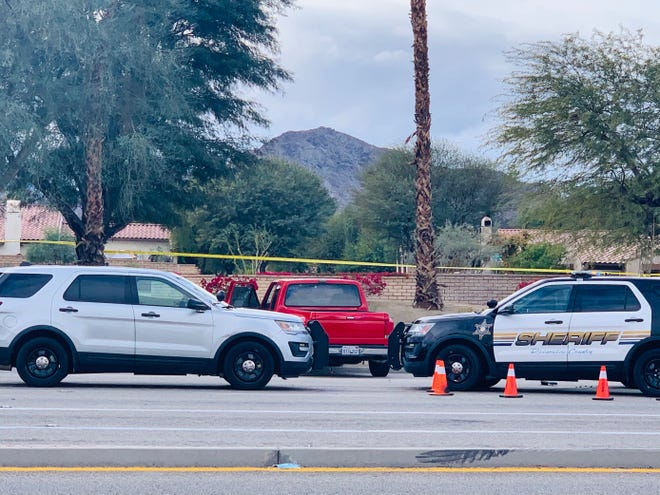 Law enforcement vehicles surround a red pickup truck that appears to be at the center of some kind of police action along Jefferson Street near Avenue 48 in La Quinta on Friday, Jan. 29, 2021.
