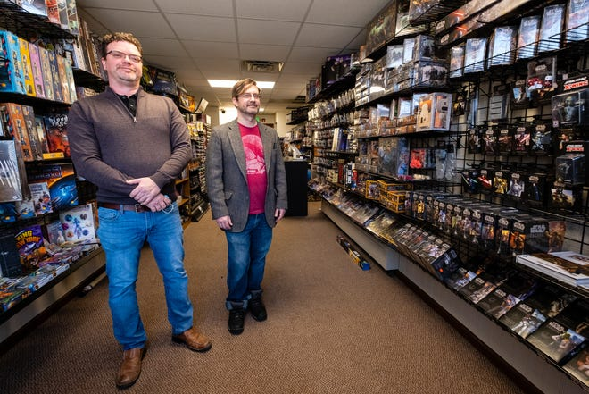 Greg Campbell, left, and his business partner Derek Helsom pose for a portrait Friday, Jan. 29, 2021, in Border Keep Games in downtown Port Huron. The two hope to have the business, which will focus on board games, miniatures, role-playing and card games, open in February.