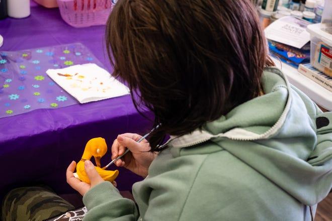 Kadin Sharrow, 14, paints a ceramic duck Thursday, Jan. 28, 2021, at A Little Hobby Ceramics Studio in Marysville.