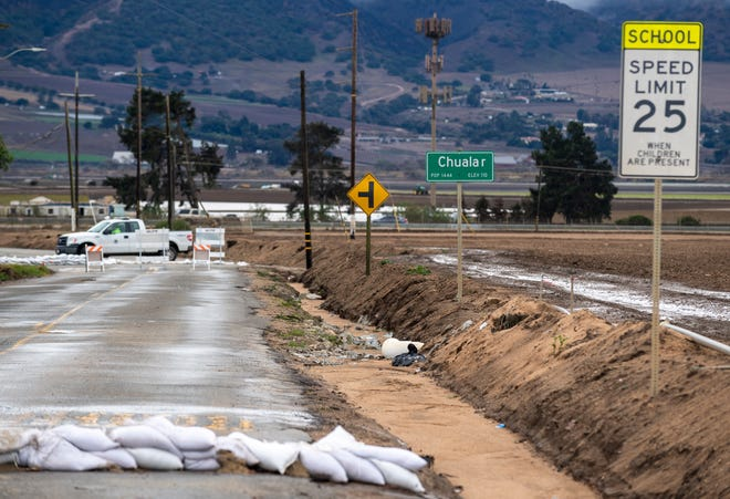 Sandbags rest on a road in Chualar, Calif., on Thursday, Jan. 28, 2021.