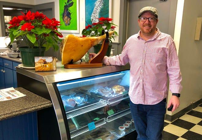 New owner of Mr. T's Deli, Daniel Friedrich, with whole prosciutto.
