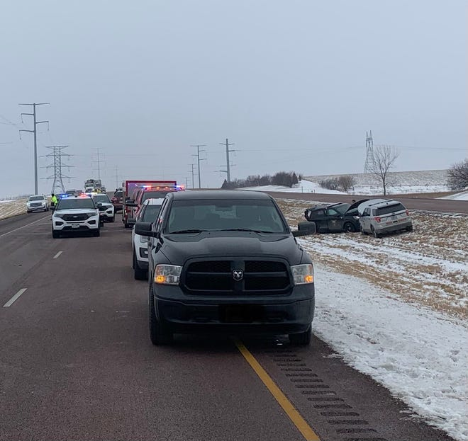 Minnehaha County Sheriff's Office working a scene of a crash on Interstate 90 east of Brandon on Friday.