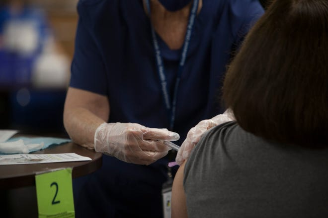 Community members receive the Covid-19 vaccine at the Southwest Utah Public Health Department Friday, Jan. 29, 2021.