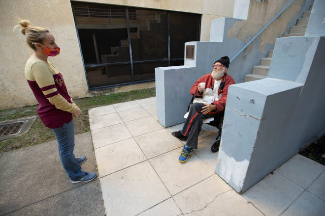 City Walk Urban Mission Executive Director Renee Miller talks with shelter client Darwin Phillips at the Mahan Drive shelter Thursday, Jan. 28, 2021.