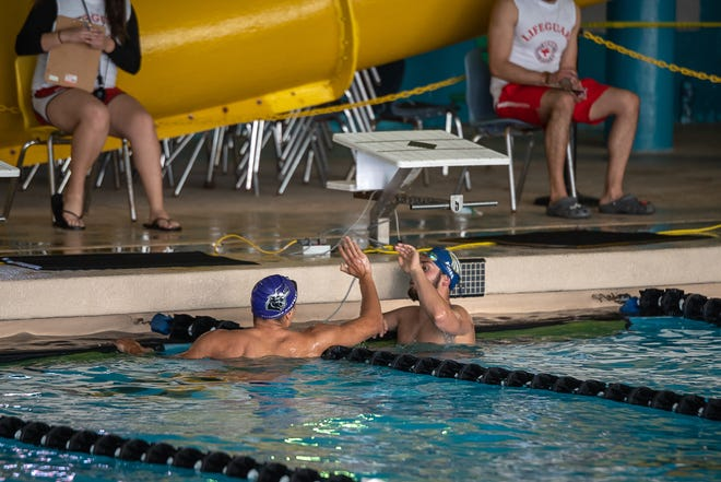 Competing swimmers congratulate each other after a race. District 1-6A boys competed at a swim meet at the SISD Aquatic Center in El Paso on Jan. 28, 2021.