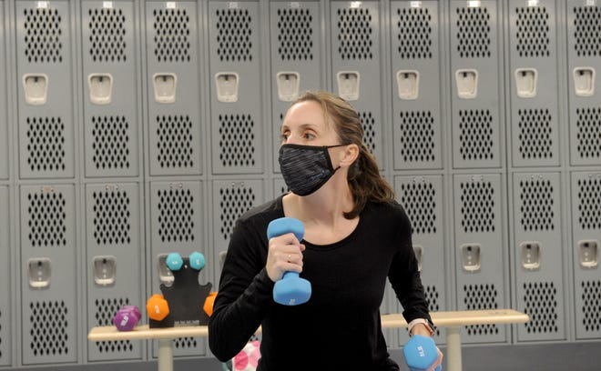 Stephanie Aquino, a physical education teacher at Santa Rosa Technology Magnet School in Camarillo, gives her eighth grade students options with weights during distance learning on Wednesday, Jan. 28, 2021. She teaches class from the girls locker room.