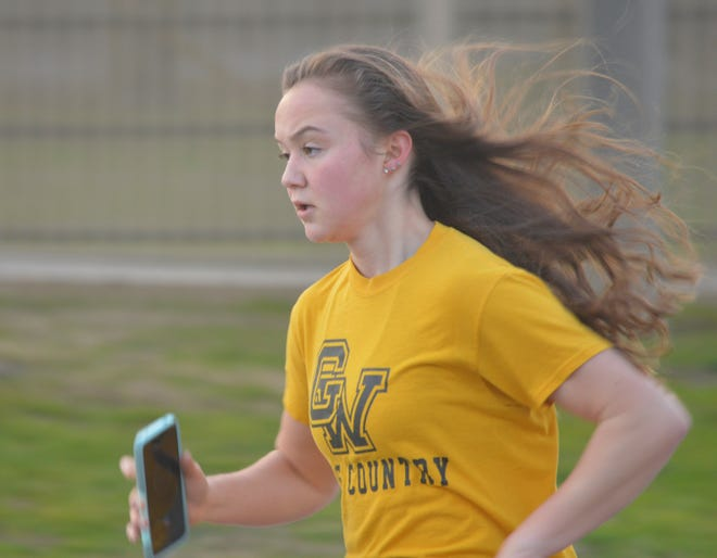 Golden West High School junior Cadence Estermann runs on Jan. 26 during conditioning workouts in Visalia.