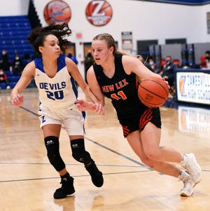 Kim Kellogg drives to the basket on Zanesville's Brooklyn Snoddy, left, during New Lexington's 52-36 win on Jan. 28 at Winland Memorial Gymnasium.