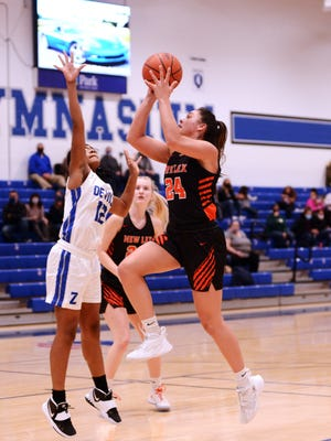 New Lexington's Aubri Spicer goes into the lane against Zanesville's Kandrea Sowers in a game earlier this season at Winland Memorial Gymnasium. Spicer was voted the MVL Small School Division player of the year after the Panthers went 10-0.