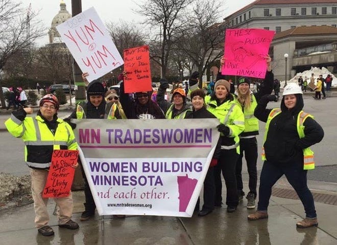 Kimberly Brinkman (third from right) rallies with other Minnesota tradeswomen. Brinkman said that in roughly two decades in the trades she has never worked a job start to finish.