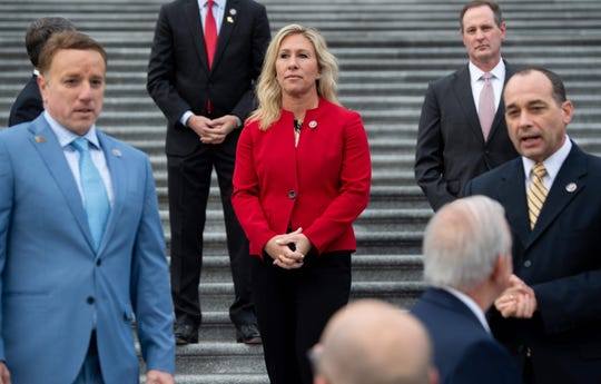 Rep. Marjorie Taylor Greene of Georgia stands alongside fellow first-term Republican members of Congress on the steps of the U.S. Capitol in Washington, DC, Jan. 4, 2021.