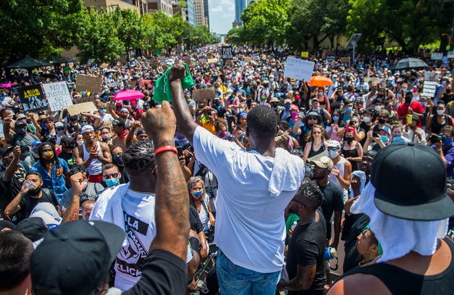 Thousands of protesters gathered peacefully on 11th street in front of the State Capitol while chanting Black Lives Matter and justice on June 7, 2020 in Austin.