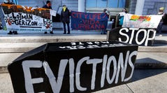 Tenants' rights advocates demonstrate in front of the Edward W. Brooke Courthouse, Wednesday, Jan. 13, 2021, in Boston. President Biden signed an executive order extending the eviction moratorium, but policy analysts have said loopholes do not universally protect tenants.