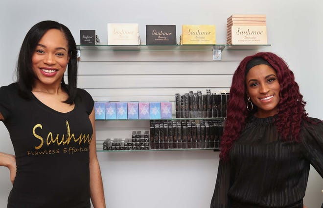 Business partner Sarah Ferguson, left, and Dwynica Pendleton, founder and owner of Sauhmor Beauty, an online beauty products company, with some of their products in Akron.