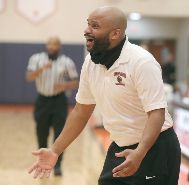 First-year Kenmore-Garfield basketball coach McNeal Thompson III said he appreciates the efforts being made to keep players safe during a pandemic but going through testing before games adds to his anxiety. [Phil Masturzo/Beacon Journal]