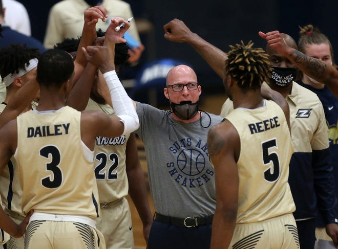 The University of Akron men's basketball team had its game against Miami University, the regular season finale, canceled Thursday afternoon due to COVID-19 issues. Coach John Groce doesn't sound concerned that their appearance in the Mid-American Conference Tournament could be affected. [Jeff Lange/Beacon Journal]