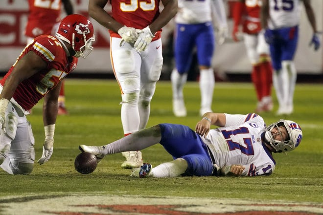 Kansas City defensive end Alex Okafor looms over Buffalo quarterback Josh Allen after a sack in the fourth quarter of the AFC championship  game last Sunday. With Okafor's appearance at the Super Bowl next Sunday, a Longhorn will have been part of the NFL's grand finale for 16 straight seasons.