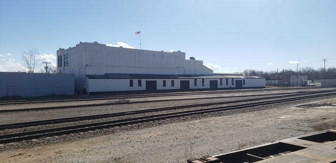 The building located at 23 D SE has recently begun a transformation as new owners have painted the loading bays and are installing a new roof.