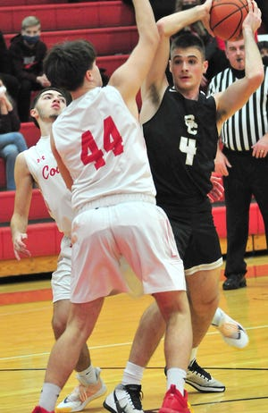 South Central's David Lamoreaux (4) looks to pass as Crestview's Mason Ringler (44) defends during high school boys basketball action Friday at Crestview High School. The Trojans beat the Cougars in overtime, 60-56.