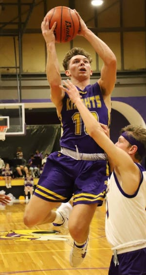 South Beauregard's Nick Uhlik (with ball) fires up a shot during the Golden Knights' win over Iowa on Friday.