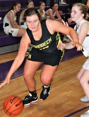 Hornbeck's Danzy Forehand (with ball) attempts to drive past Hicks' guard Reese Stephens during the Lady Pirates' 64-39 victory over the Lady Hornets on Friday in Rosepine.