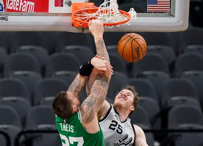 Celtics center Daniel Theis scores over Spurs center Jakob Poeltl in San Antonio on Wednesday.