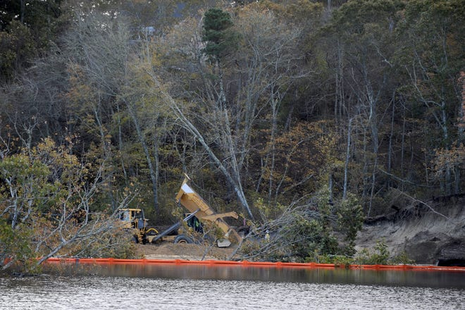 Materials that fell into Lily Pond in East Sandwich after a portion of railroad track collapsed in October remain in the pond. The town's Conservation Commission is asking the state Department of Transportation to restore the pond to the condition it was in before the accident. [Merrily Cassidy/Cape Cod Times file]