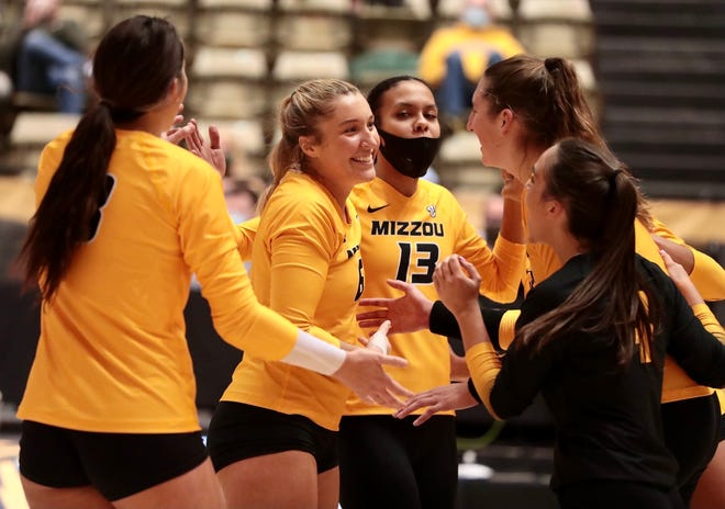 Members of the Missouri volleyball team greet each other during a match against LSU on Friday night at the Hearnes Center.