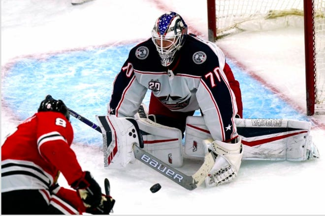 Joonas Korpisalo makes a save against the Blackhawks' Dominik Kubalik in the second period of the Blue Jackets' 2-1 win in Chicago. It was one of 31 saves for Korpisalo.
