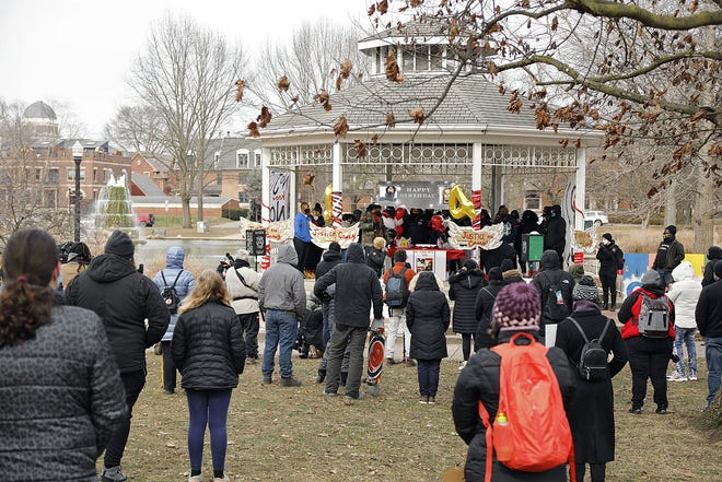 A crowd gathers at the Goodale Park Gazebo, where there were marker boards with the names of about 30 people killed by police in central Ohiofrom 1970 to present.
