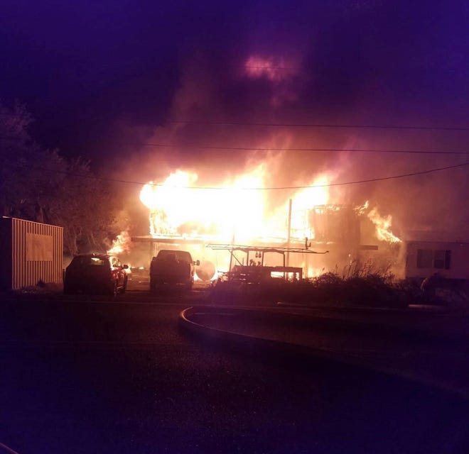 A resident's photo captures the fire that ripped through a house Thursday night in Theriot.