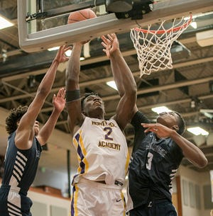 Montverde Academy's Jalen Duren (2) tries to score during Friday's game against LaPorte (Indiana) La Lumiere at the Montverde Academy Inviational Tournament at the EdgeCenter for Sportsmanship and Wellness in Montverde. [PAUL RYAN / CORRESPONDENT]