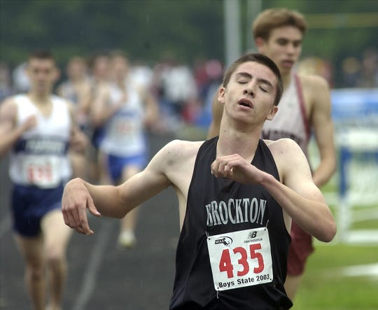 Brockton's Keith Gill (435) at the end of the boys mile at the 2003 All State Meet Championship at Norwell on June 7, 2003.