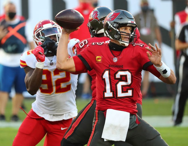 Tampa Bay Buccaneers quarterback Tom Brady (12) throws as Kansas City Chiefs defensive end Tanoh Kpassagnon (92) moves in during their regular season matchup earlier this season. Brady completed an already stacked roster to get the Bucs to the Super Bowl for the first time since 2002.