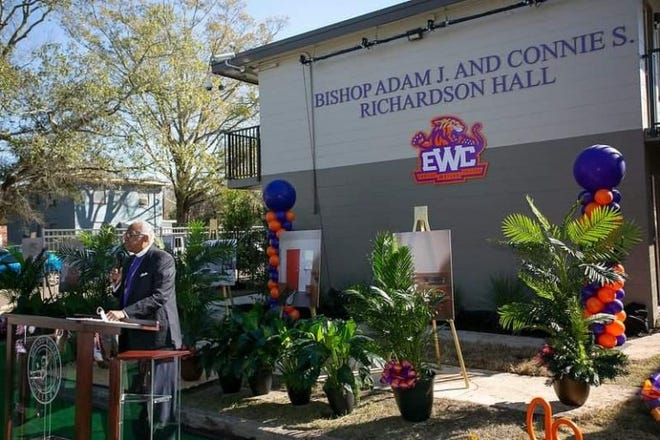Bishop Adam Richardson Jr. addresses the audience during Saturday's unveiling of Edward Waters College's newly renovated and named student residential facility in honor of him and his wife.