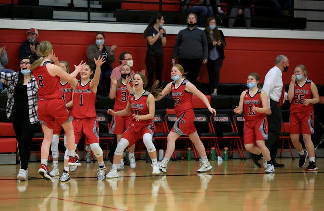Little River players celebrate their championship win over Central Christian at the Fairfield Lady Falcon Invitational Tournament Friday night. Little River defeated Central Christian 38-28.